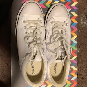 White leather converse sneakers.